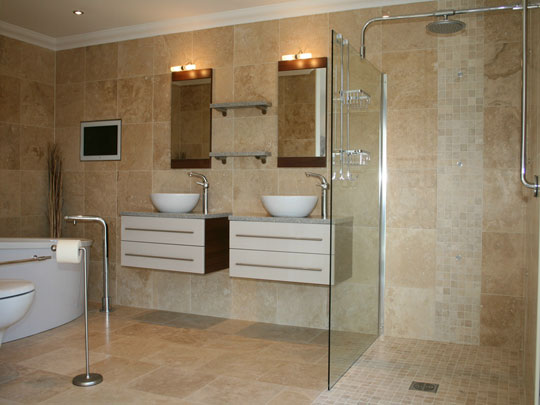 Bathroom with Travertine Flooring and Patterned Accents
